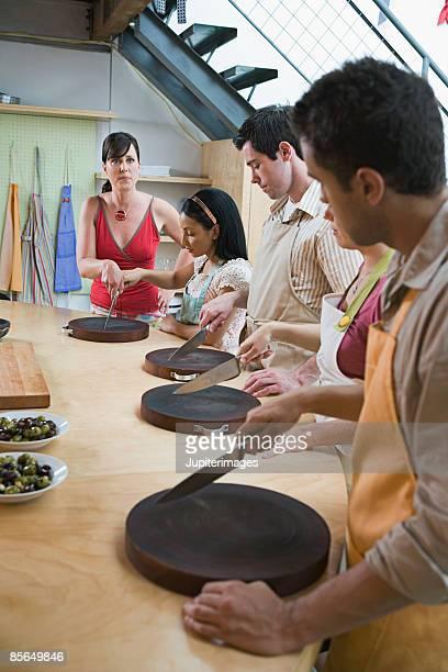 Woman teaching chopping technique