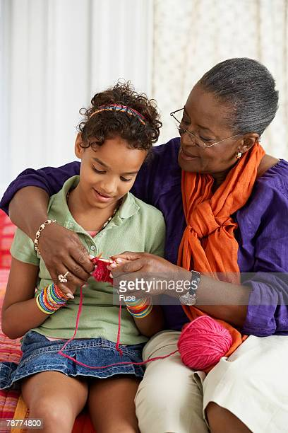 Woman Teaching Granddaughter to Knit