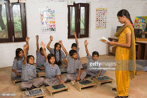 Woman teaching students in a classroom