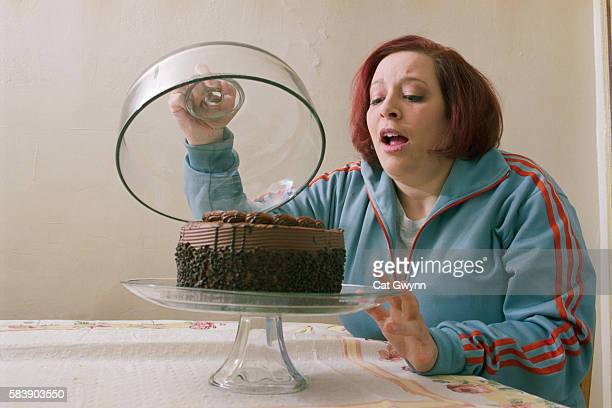 Woman Tempted by Chocolate Cake