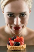 Woman tempted by fruit tart