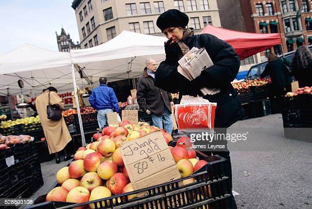 A woman tests a Johna Gold apple at Union Square's Greenmarket in Manhattan