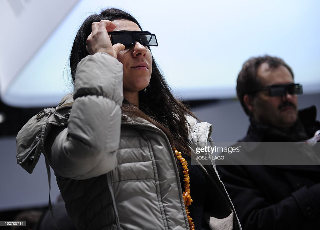 A woman tests a new Samsung 3D device in Barcelona on February 26, 2013, on the second day of the 2013 Mobile World Congress. The 2013 Mobile World Congress, the world's biggest mobile fair, is held from February 25 to 28 in Barcelona. AFP PHOTO / JOSEP LAGO