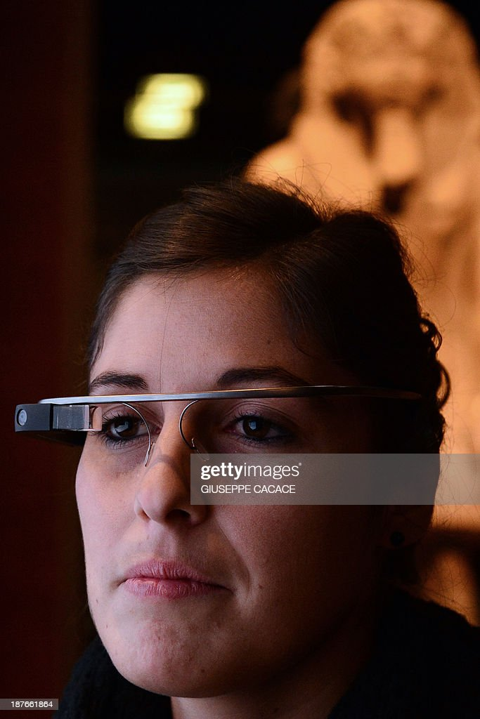 A woman tests a pair of Google glasses equiped with LIS (Italian Sign Language - 'Linguaggio Italiano dei Segni') capabilities and created to help deaf people during their visit of the Egyptian Museum in Turin, on November 11, 2013. The Museum of Egyptian Antiquity ('Museo delle Antichite Egizie') in Turin is dedicated solely to Egyptian art and culture, and it is the first museum of its kind to use the interactive glasses to assist deaf people during their visit. An actor using sign language is projected onto the small video screen integrated into the glasses, thereby providing historical information and explanations to deaf visitors throughout the exhibition.