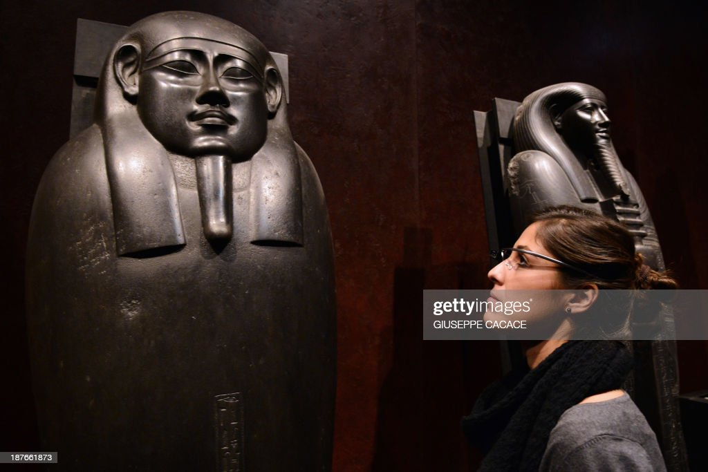 A woman tests a pair of Google glasses equiped with LIS (Italian Sign Language - 'Linguaggio Italiano dei Segni') capabilities and created to help deaf people during their visit of the Egyptian Museum in Turin, on November 11, 2013. The Museum of Egyptian Antiquity ('Museo delle Antichite Egizie') in Turin is dedicated solely to Egyptian art and culture, and it is the first museum of its kind to use the interactive glasses to assist deaf people during their visit. An actor using sign language is projected onto the small video screen integrated into the glasses, thereby providing historical information and explanations to deaf visitors throughout the exhibition. AFP PHOTO / GIUSEPPE CACACE