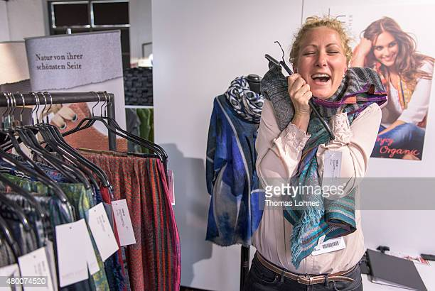 A woman tests sleeve made by the label 'Yam Yam' at the Ethical Fashion Show Berlin during the MercedesBenz Fashion Week Berlin Spring/Summer 2016 at...