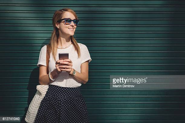 Woman texting and smiling to someone