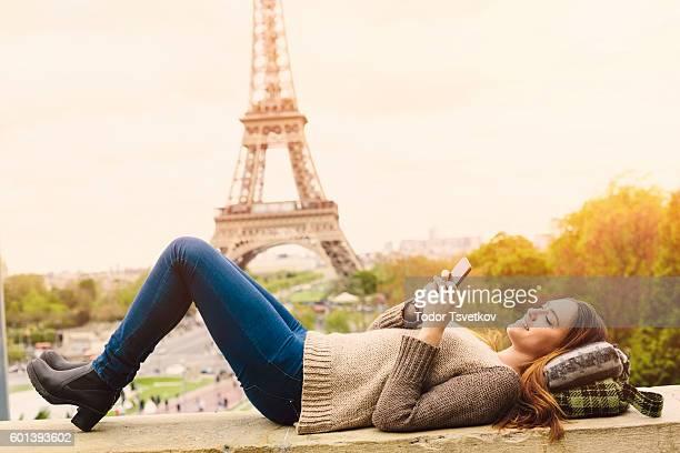 Woman texting in Paris