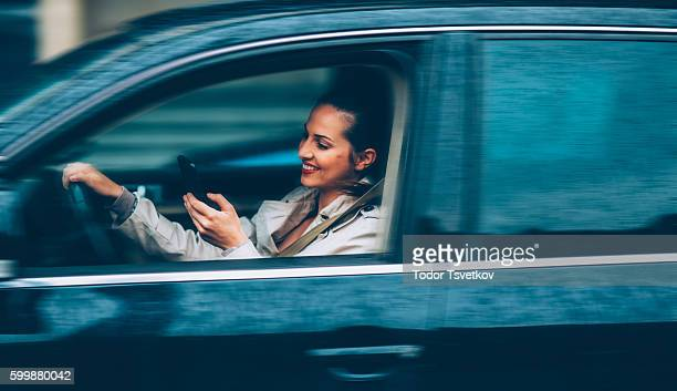 Woman texting in the car