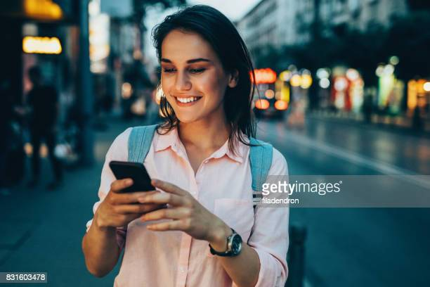 Woman texting in the city