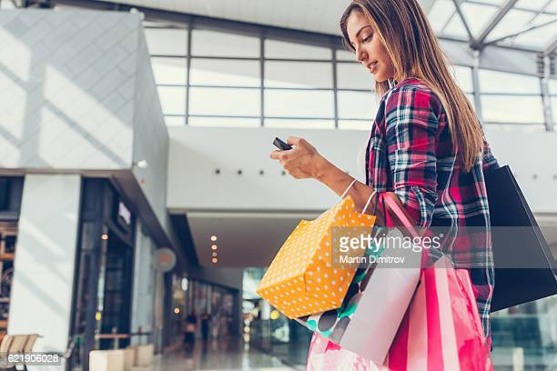Woman texting in the shopping mall