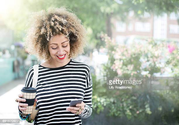 Woman texting in urban environment