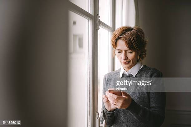 woman texting on her mobile phone