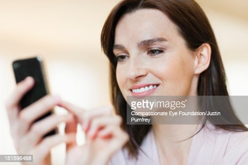 Woman texting on mobile phone : Stock Photo