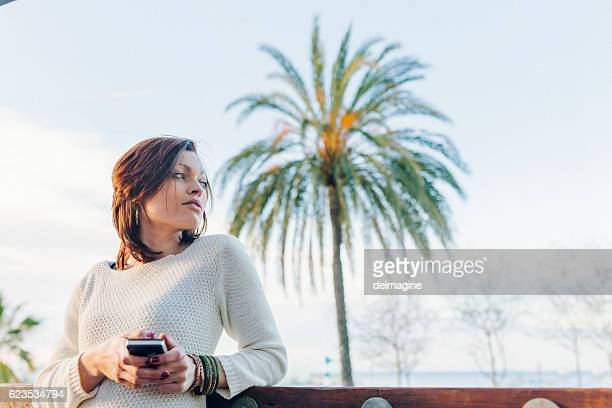 Woman texting on the smartphone