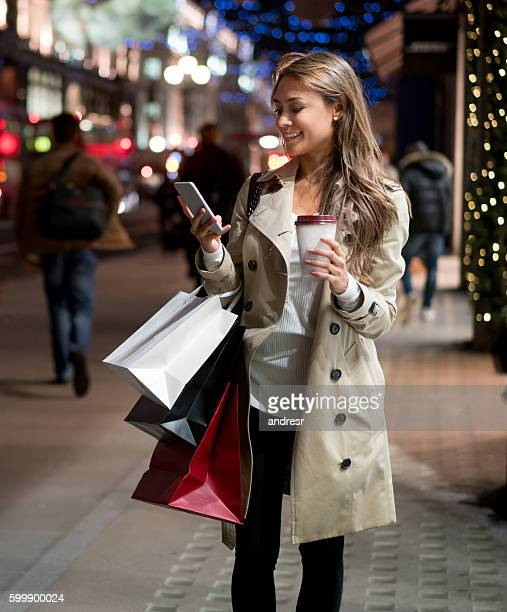 Woman texting while Christmas shopping