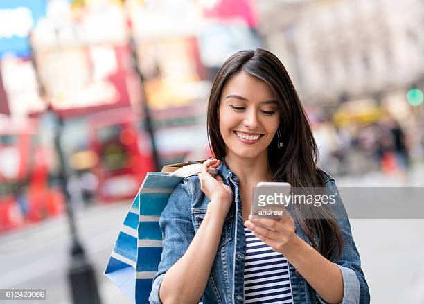 Woman texting while shopping