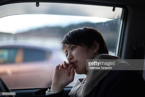 Woman thinking about her future in her car