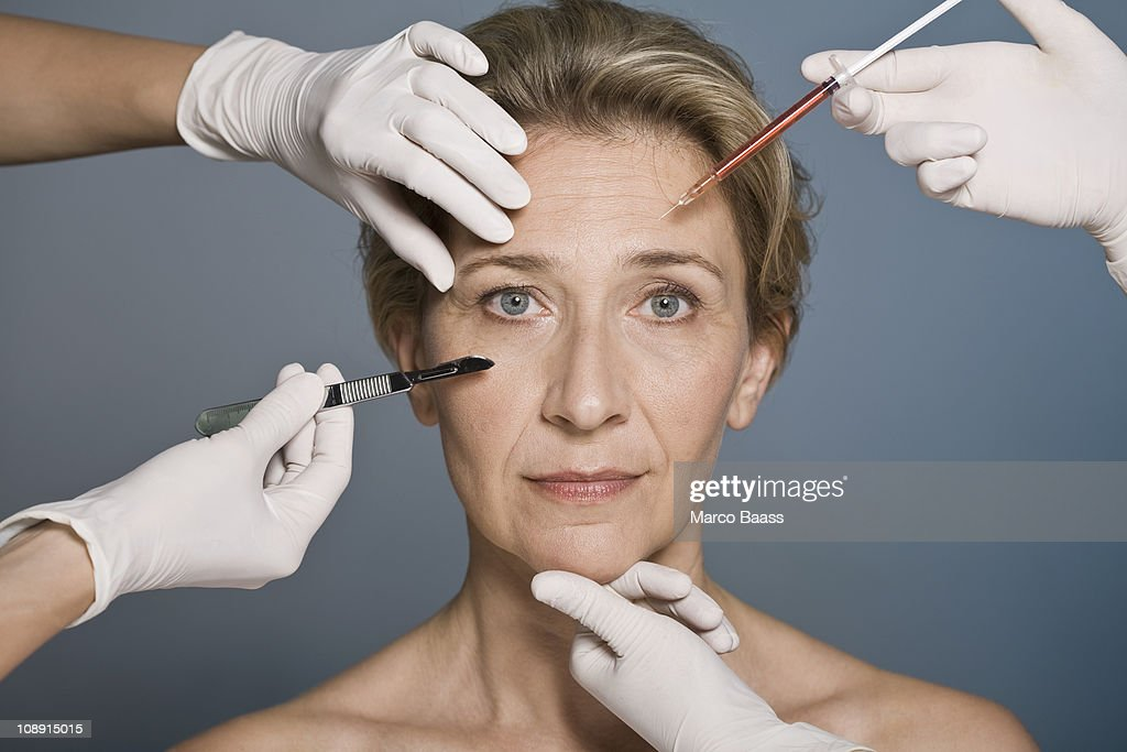 Woman thinking about plastic surgery
