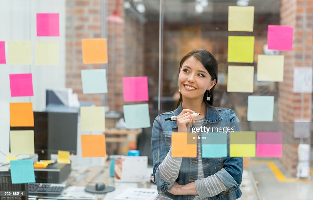 Woman thinking of ideas at the office : Stock Photo