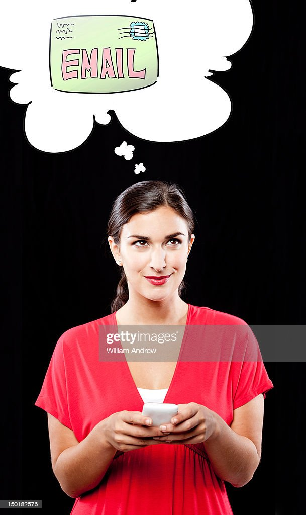 A woman thinks of email while using smartphone : Stock Photo