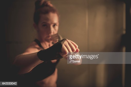 Woman Throwing a Punch