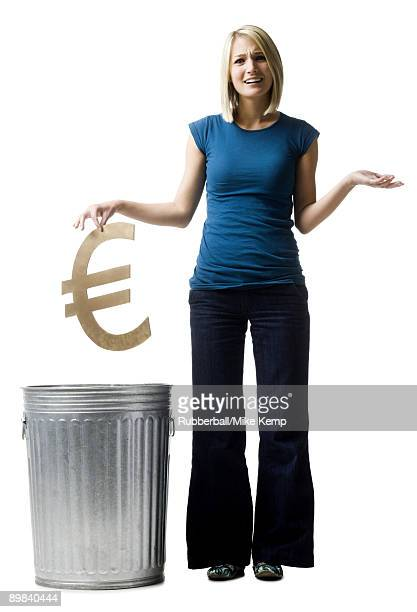 woman throwing euro symbol in the trash