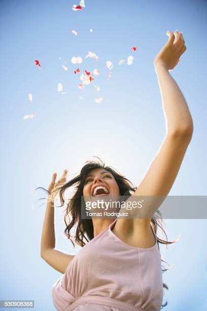 Woman throwing flower petals in the air