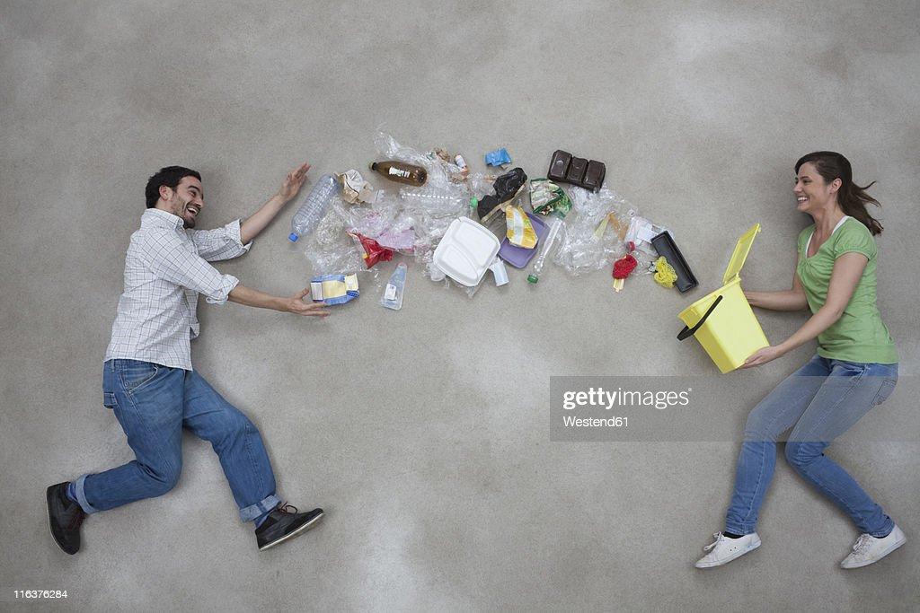 Woman throwing garbage towards man