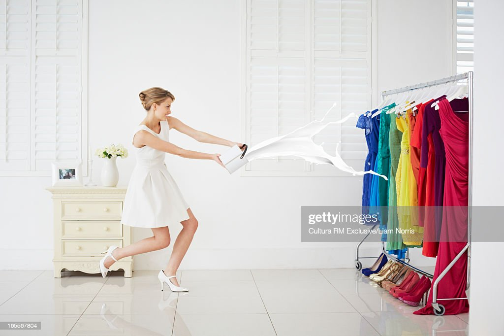 Woman throwing paint on clothes