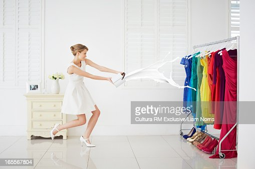 Woman throwing paint on clothes stock photo getty images for Paint on clothes