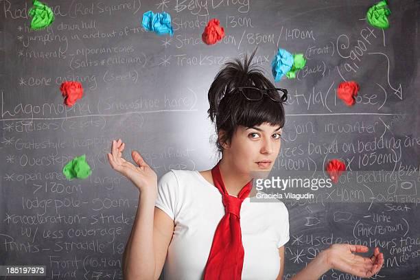 Woman throwing paper balls
