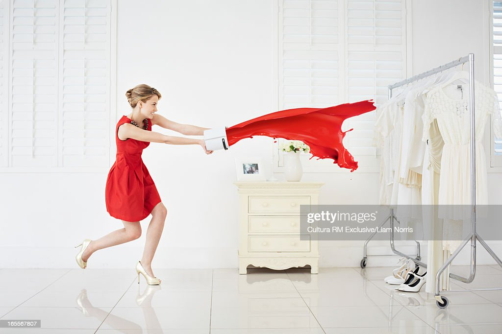 Woman throwing red paint on clothes