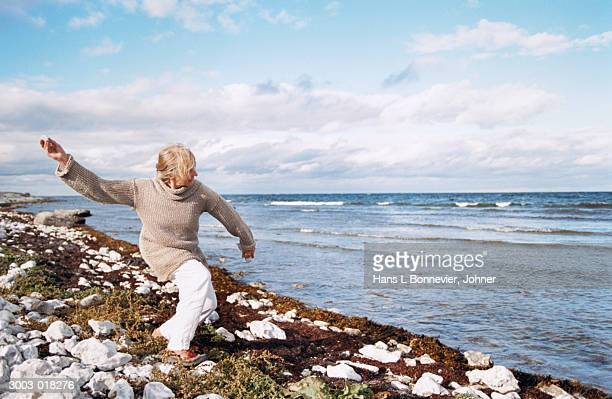 Woman Throwing Stone