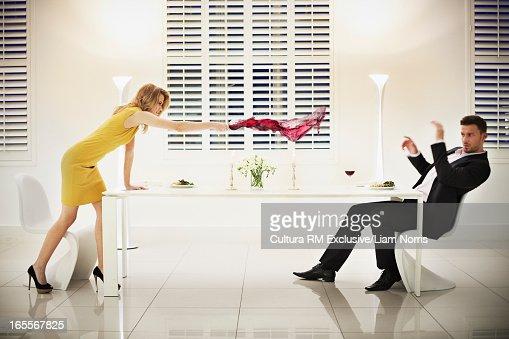 Woman throwing wine at boyfriend