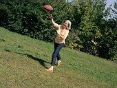 Woman throwng rugby ball.