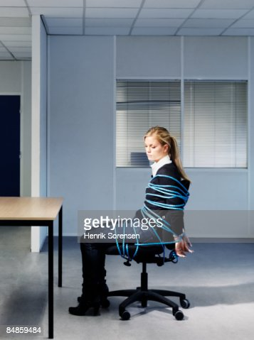 Woman tied to her office chair.