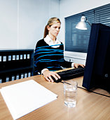 Woman tied to her office chair whilst working