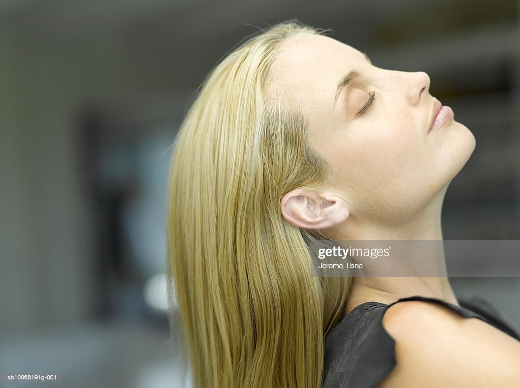 Woman Tilting Head Back Side View Close Up Stock Photo ...