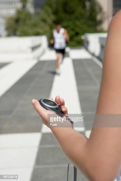 Woman Timing Man Running