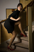 Woman Tiptoeing Up the Stairs