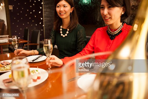 Woman to hear story of  friend over  cup of champagne : Stock Photo