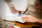 Woman to operate the sewing machine