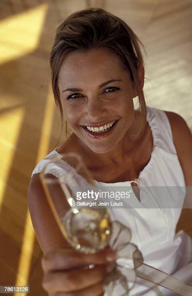 Woman toasting with champagne glass