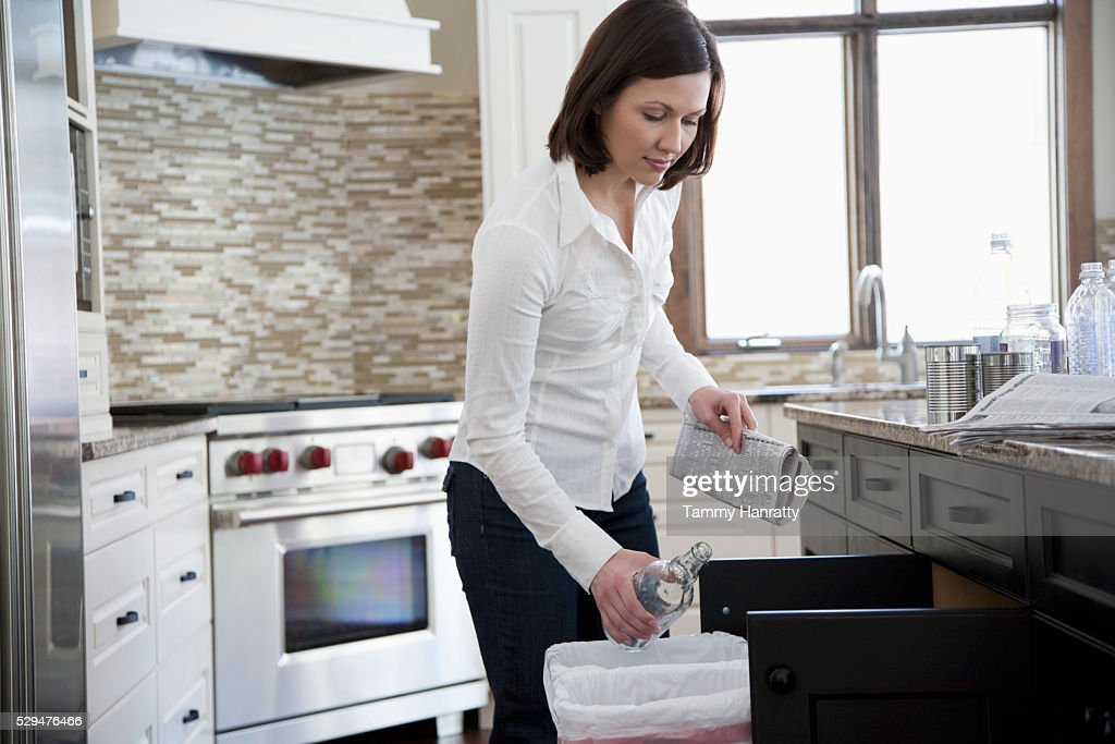 Woman tossing an empty bottle away : Photo