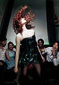 Woman tossing her hair in nightclub