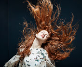 Woman tossing her hair in the wind.
