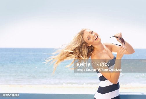 Woman tossing her hair on beach : Stock Photo