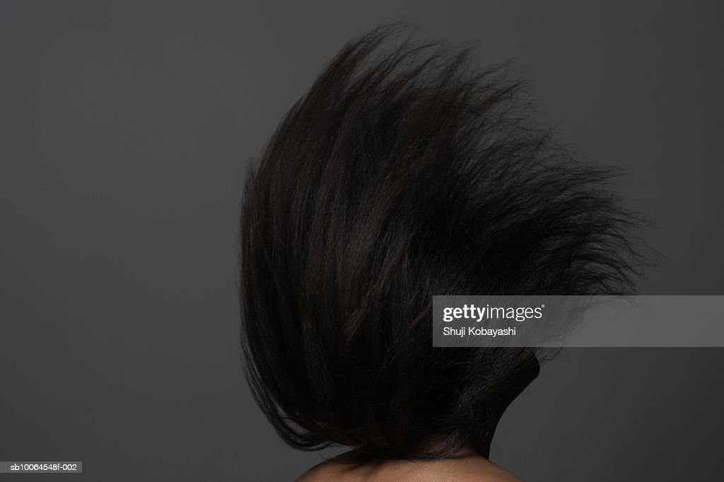 Woman tossing long black hair : Stock Photo
