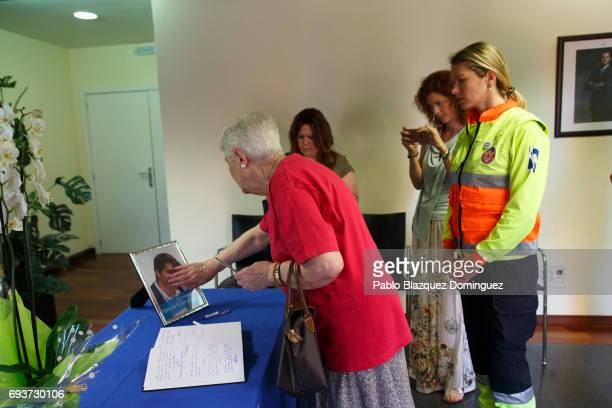 A woman touches a picture of Ignacio Echevarria after signing a condolence book ahead of a vigil to honour London Bridge terror attack hero Ignacio...
